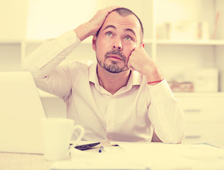 Disappointed worker feeling stressed