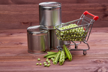 Canned peas and fresh peas in shopping trolley.