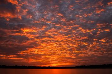 Impressive sunrise with clouds over Rio Negro, Anavilhanas Archipelago, Brazil