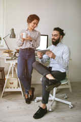 Young adults hipster male and female working at home
