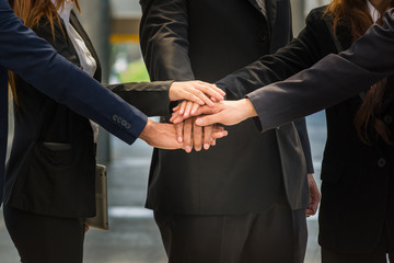 BusinessPeople unite their Hand as Stack to motivate group network