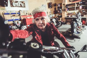 Calm old woman riding bike