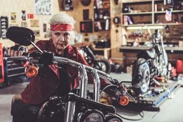 Cool pensioner locating on bike