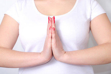 adult woman crossed her arms in front of chest in a pose yoga