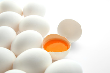Raw eggs with yolk on white background
