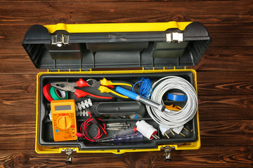 Instrument box for wiring on wooden background