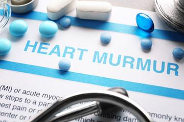 Diagnosis HEART MURMUR on medical report and medicines closeup