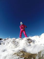 Skier in ski suit enjoying in mountain.