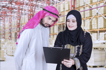 Muslim business team discussing with a clipboard