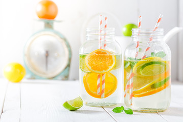 Sparkling water with citrus fruits and mint leaves
