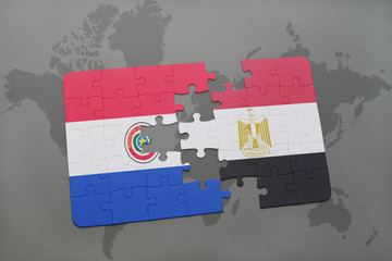 puzzle with the national flag of paraguay and egypt on a world map