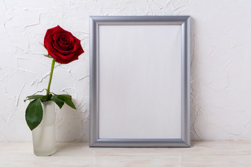 Silver frame mockup with red rose in glass vase