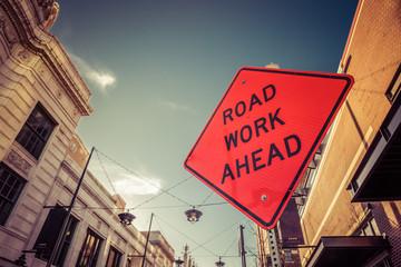 Road Work Ahead Orange Street Sign In City