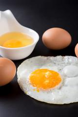 fried eggs on black background, egg