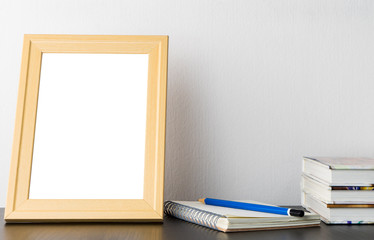 Blank wooden Picture Frame on reading table
