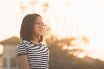 Asian girl wearing glasses looking