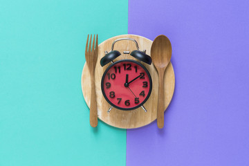Meal time with alarm clock at lunch time