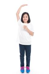 Asian girl holding glass of milk on white background