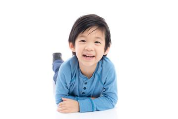 asian boy lying on white background