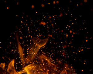 Deurstickers Vuur fire flames with sparks on a black background