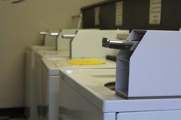 Laundromat washing machine that uses quarters
