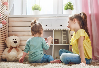 girls play with doll house