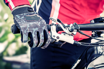 Close up hand with glove of bicycle sport