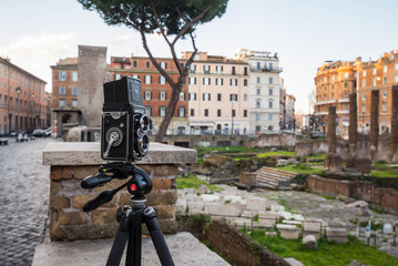 Taking pictures at Largo di Torre Argentina at sunrise, Rome, Italy