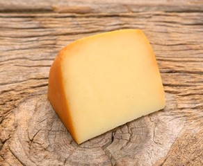 piece of cheese on wooden