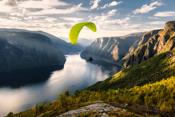 Photo sur Toile Aerien Paraglider silhouette flying over Aurlandfjord, Norway
