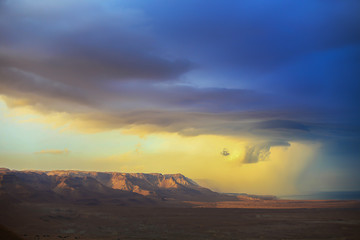 The storm over mountain Masada in Israel. The dramatic landscape, dark blue sky above the mountain.