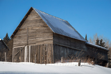 Snowy barn in the sunshine in Northern Ontario