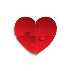 Jigsaw puzzle pieces in form of red heart.