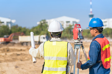 Construction engineer and foreman worker checking construction site for new Infrastructure construction project