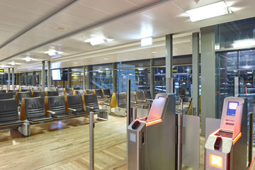 Airport boarding pass control area. Travel and tourism background.