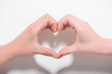 Valentines day and love concept.Two hands making heart shape on white background.