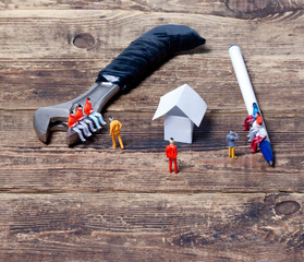 tools, toy people and paper house