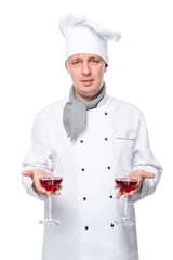 Chef holds two glass of red wine on a white background