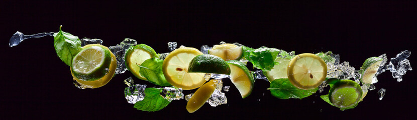 lime , lemon and  peppermint on a black background