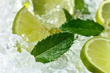 lime slices and mint leaves on ice