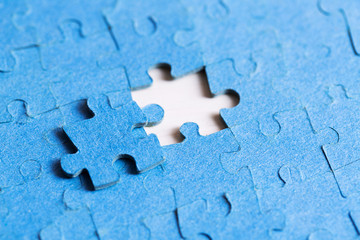 problem solved concept - placing last piece of jigsaw puzzle