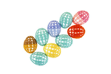 Easter eggs are in lacy multi-colored clothes isolated