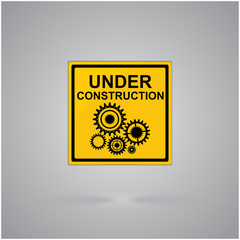 Warning attention sign.Under construction concept, draw with gear wheels.