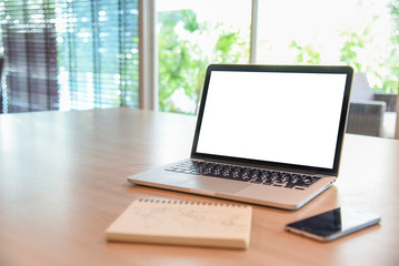 Business laptop on wooden office desk