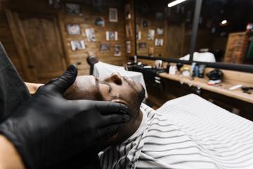 Young man having professional facial massage