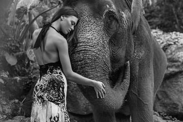 Black&white portrait of a woman hugging an elephant