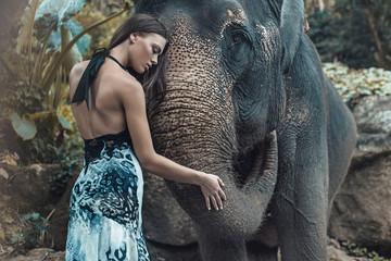 Pretty lady hugging a lovely indian elephant