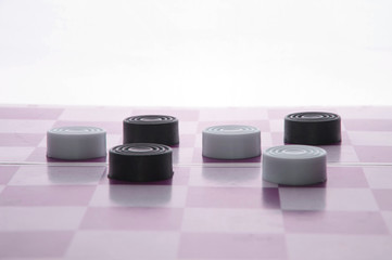 checkers on a chess Board