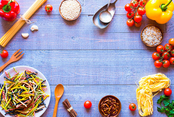 Pasta background with vegetables, Free space for text. Top view