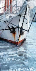 Sailing ship in frozen canal